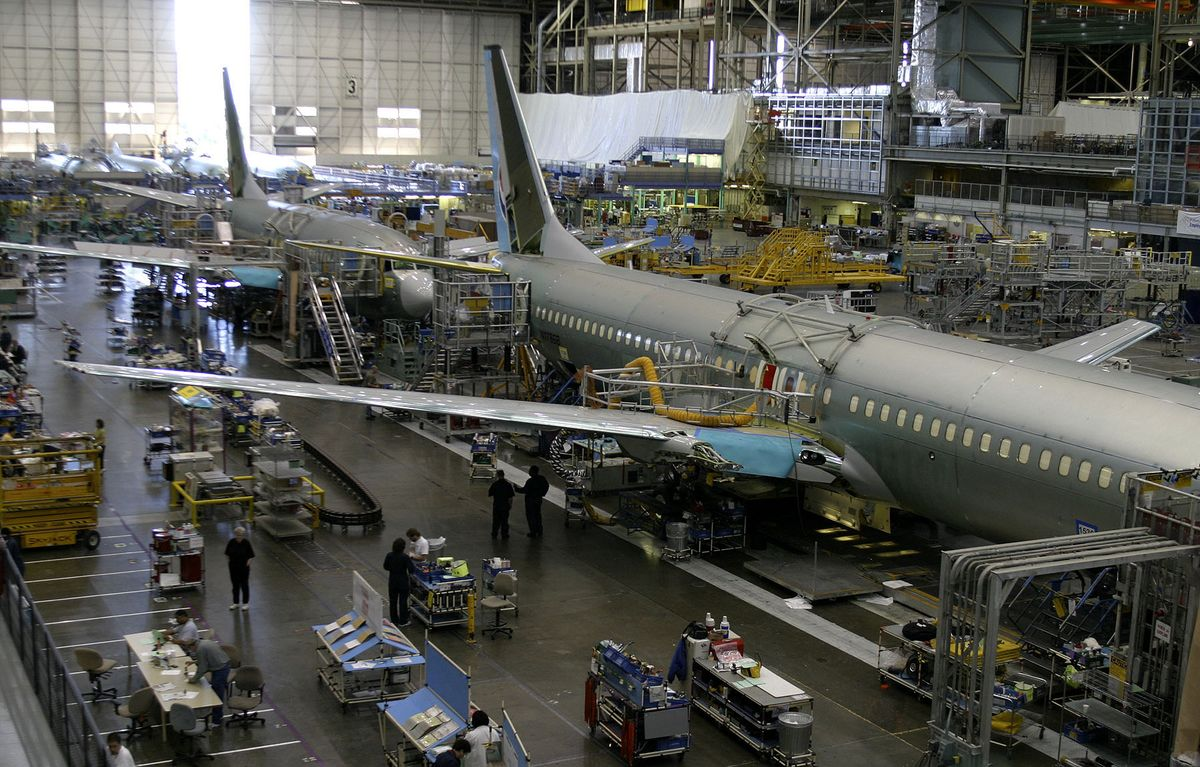 Boeing Weighs Wide-Body Jet Cuts, Plans Buyouts on 'New Reality'
