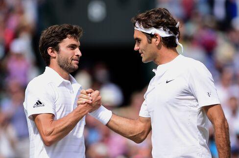 Gilles Simon and Roger Federer