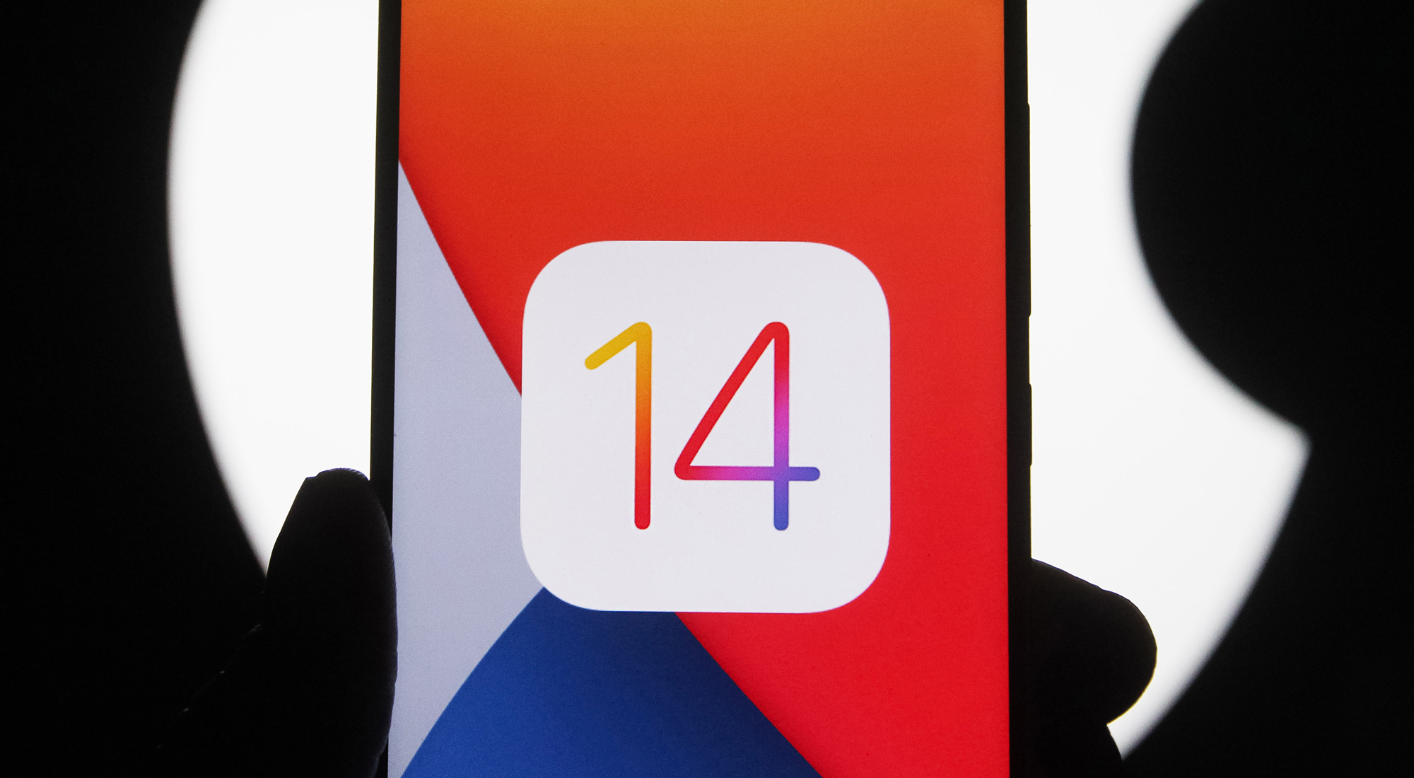 In this photo illustration the iOS 14 logo of the iOS mobile