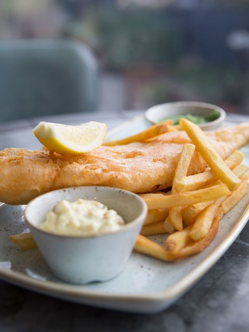 Fish is served with chips and mushy peas. The cod is as good as it gets.