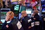 Traders work on the floor of the New York Stock Exchange (NYSE) in New York, U.S..