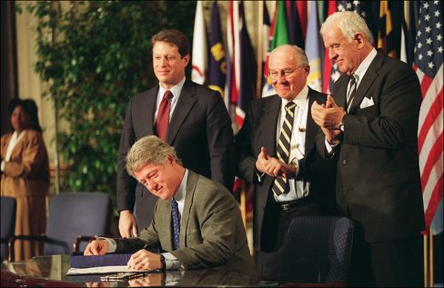 President Bill Clinton signs the North American Free Trade Agreement on Dec. 8, 1993.