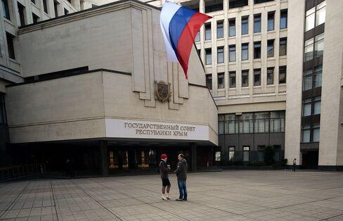 A Russian Flag Flies Outside the Crimean Parliamant Building