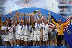 The U.S.women's national soccer teamcelebrates with the trophy after their World Cup win againstthe Netherlands,in Lyon, central-eastern France in 2019.