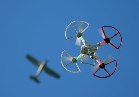 A recreational drone flies underneath a plane in New York