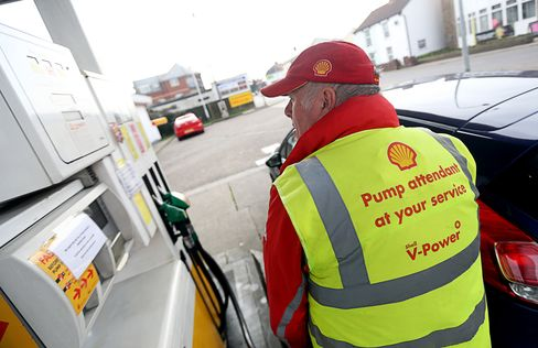 An attendant fills a customer's car at a Shell petrol station in Clacton-on-Sea, U.K.
