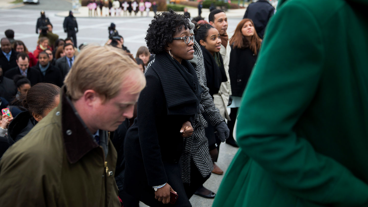 Congressional staff members walk up the U.S. Capitol steps during a protest in Washington on Dec. 11, 2014.