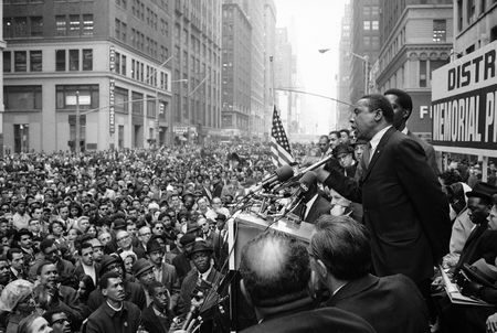 """Floyd McKissick, head of the Congress of Racial Equality, addresses a crowd of Garment District workers who stopped work to attend a memorial meeting for Dr. Martin Luther King Jr. at Seventh Avenue and 37th Street in New York, on April 8, 1968. McKissick told the crowd: """"The reason you're here today is because of an act of violence."""""""