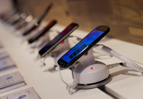 Acquirers Use Stock to Fund Takeover Boom