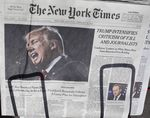 The front page of the New York Times carries a picture of President Donald Trump February 25, 2017 a day after he criticized in a speech the FBI and journalists in New York City.