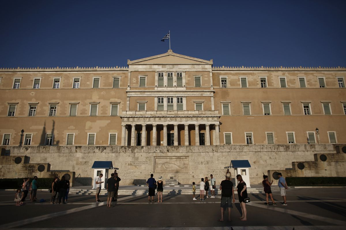 Yield Hunters Eye Greek Government Moves on Early Debt Repayment
