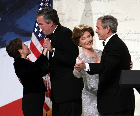 Then-President George W. Bush and his brother Jeb dance with their wives, Laura and Columba, during inaugural festivities in 2005.
