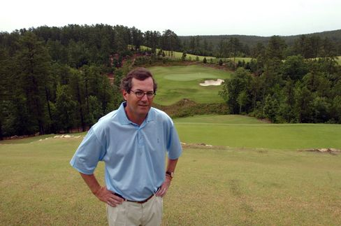 Alotian Golf Club owner Warren Stephens poses on the sixth hole tee box of the course on Wednesday, May 30, 2006 in Roland, Arkansas.
