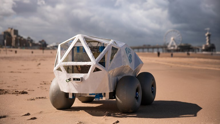The garbage-collectingBeachBot rover during a demonstration at a beach in the Netherlands.
