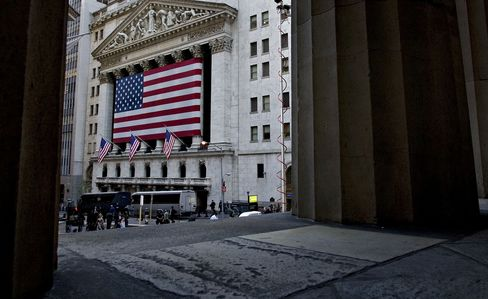 The U.S. flag hangs on the exterior of the New York Stock Ex