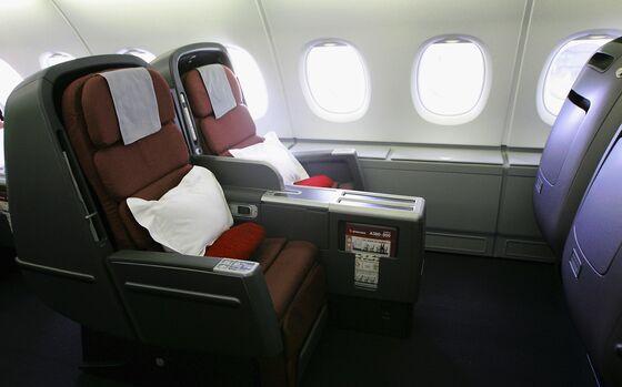 Qantas Sells Old Seats, Holidays to Travellers Awash With Miles