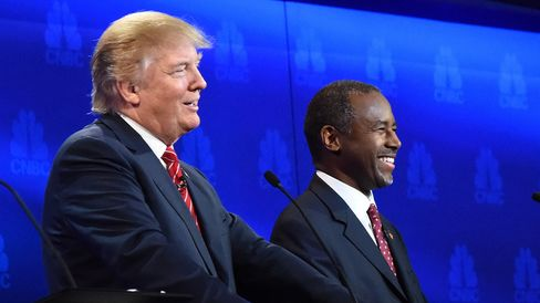 Republican presidential hopefuls Ben Carson and Donald Trump smile during the CNBC debate on Oct. 28, 2015, in Boulder, Colorado.