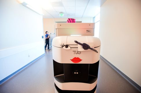 A TUG robotic courier carries supplies through the UCSF Medical Center.