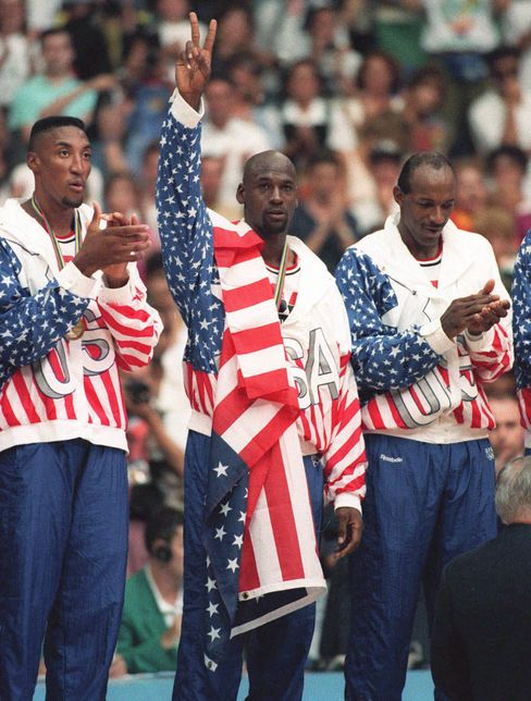 USA's Scottie Pippen, left, with Michael Jordan, center, and Clyde Drexler, with their gold medals, on Aug. 8, 1992.