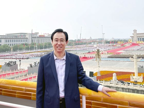 Evergrande Founder's Photo-Op Gives Bonds a Rare Boost