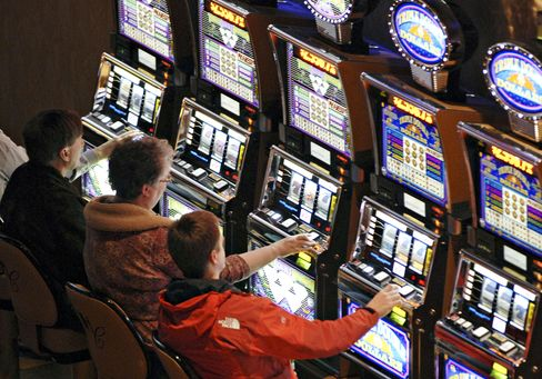 Patrons play slot machines