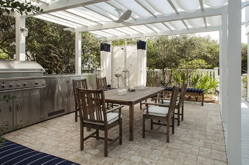 A terrace with an outdoor grill.