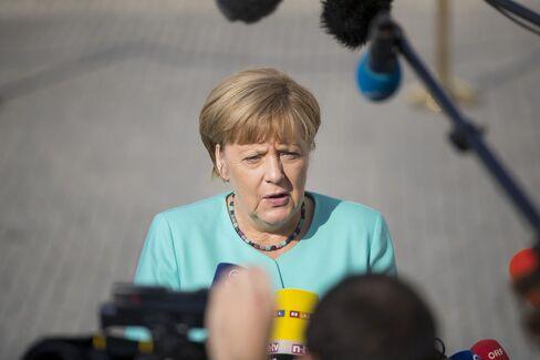 Angela Merkel, Germany's chancellor, speaks to journalists in Bratislava, Sept. 16