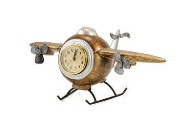 Statuette of vintage airplane with clock isolated on white background