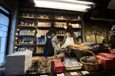 Customers shop for chocolate in a Cacao Store in Tokyo.