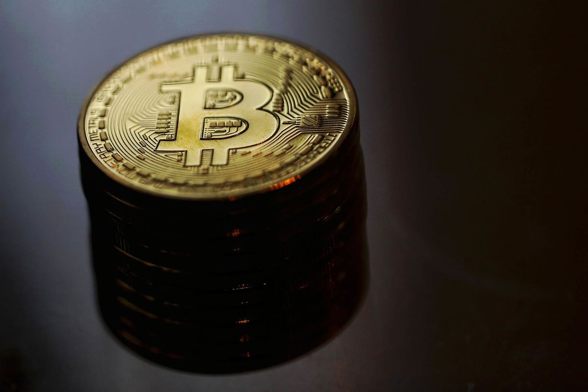 Bitcoin, Ether Lead Digital Currency Slide From Highs