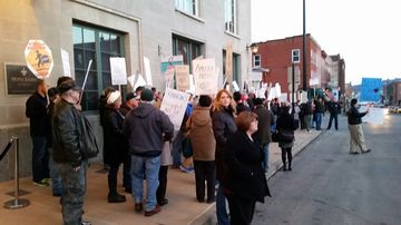 Union protesters outside the hotel where Wisconsin Governor Scott Walker spoke March 7, 2015.