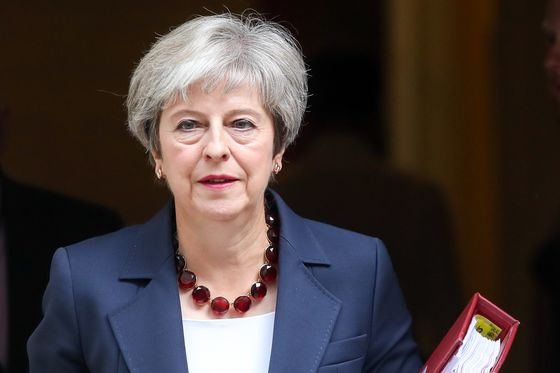 May Braces for Key Brexit Talks as Johnson Fires New Warning