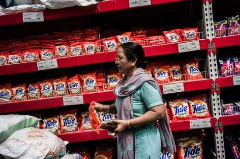 A Shopper Takes a Bag of Procter & Gamble Tide Detergent