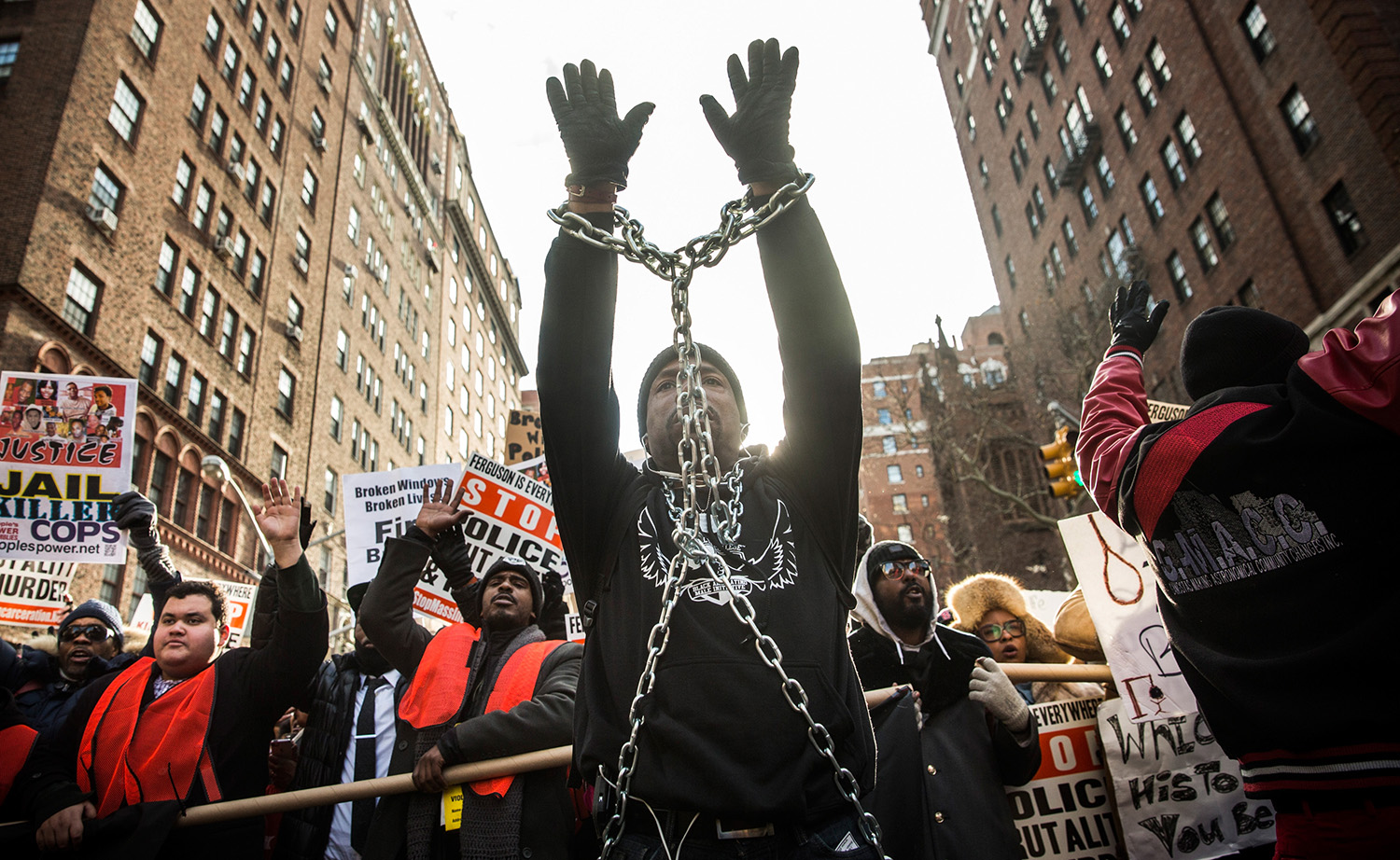 A man is wrapped in chains as people march in the National March Against Police Violence, which was organized by National Action Network, through the streets of Manhattan on December 13, 2014 in New York City.