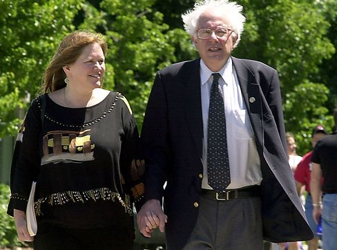 Bernie Sanders walks and his wife, Jane, during his re-election kickoff in Burlington, Vermont, in this June 24, 2002, file photo.