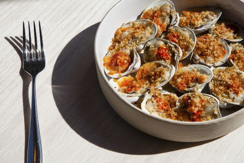 The restaurant serves fantastic Italian food such as these grilled clams under spicy breadcrumbs.