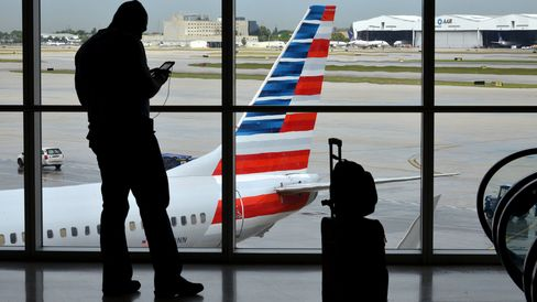 A traveler is seen at the American Airlines Group Inc. terminal of Miami International Airport.