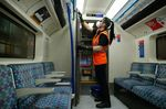 An employee of Transport for London cleans the drivers cabin door during a deep clean operation of a train used on the Victoria Line of London Underground network, at the Northumberland Park Railway Depot, operated by Transport for London, in London, U.K.