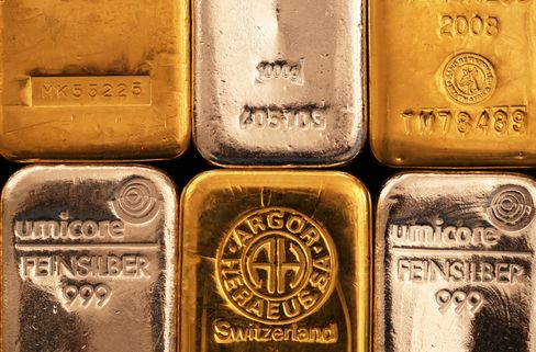 Silver and Gold Bars Sit in a Bullion Dealers in London