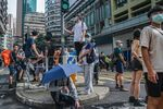 People take rest at the bollard during an anti-National Security Law protest in Hong Kong, China.