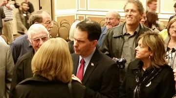 Wisconsin Governor Scott Walker meets with prospective Republican voters after his March 7, 2015, appearance in Dubuque, Iowa.