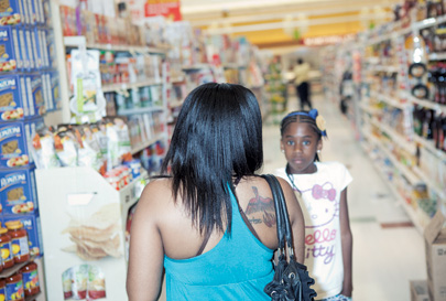 Lazarus, with her daughter, Ahhsha, is working to move to the middle class