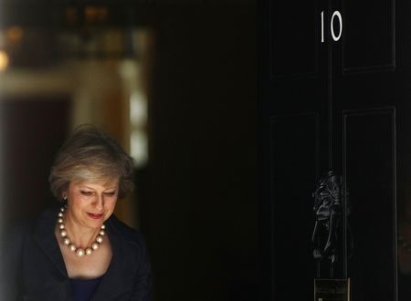 Theresa May departs a cabinet meeting before becoming Prime Minister at 10 Downing Street in London.