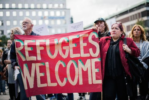 Demonstrators hold a banner in solidarity with refugees in Stockholm on Sept. 12.