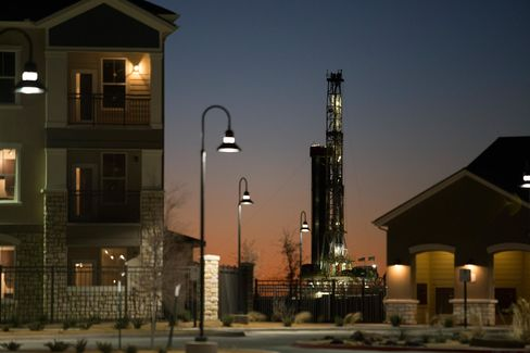 An new oil well is drilled near new apartments in Midland, Texas.