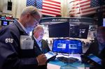 Traders On Floor Of NYSE As U.S. Markets Reopen After Holiday