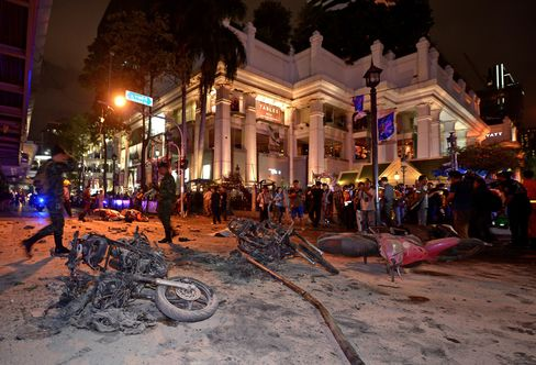 Thai soldiers inspect the scene after an explosion outside a religious shrine in central Bangkok.  Photographer: Pornchai Kittiwongsakul/AFP/Getty Images
