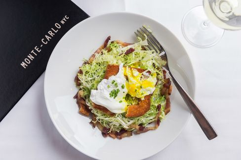 A simple salad of frisee aux lardons, or frisee leaves with pork belly and a softly poached egg.