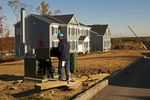 A worker installs electricity in a new housing development in Westchester County.