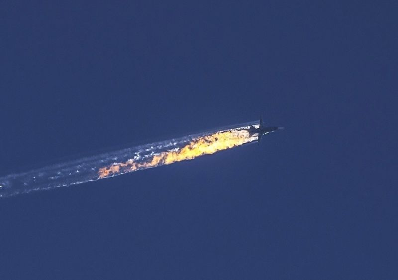 Russian warplane violating Turkish airspace is downed in Kizildag region of Turkey's Hatay province, close to the Syrian border, on November 24, 2015. A jet brought down after violating Turkish airspace was given 10 warnings over a five-minute period. (Photo by Fatih Aktas/Anadolu Agency/Getty Images)